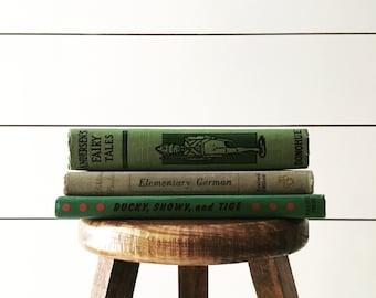 Set of three vintage green books