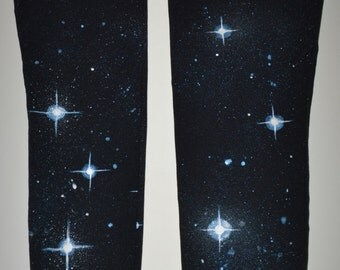 White and blue stars on black American apparel leggings. galaxy, space pants, space leggings, cosmic, tights, camping, festival