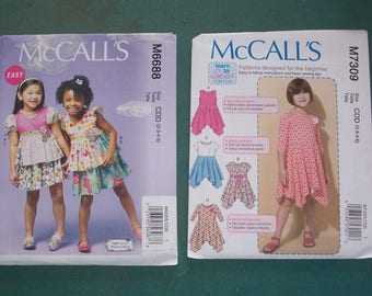 McCalls 6688 or McCalls 7309....Little Girl's Clothing Pattern...Summer Dresses...Very Pretty and Easy to Make...Uncut and Factory Folded..