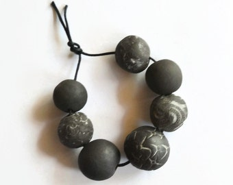 Black beads, handmade clay beads,  African Beads, boho beads, unglazed, 7 white black textured  beads