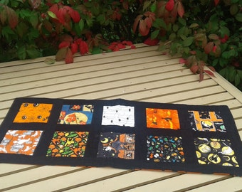 Halloween Quilted Table Runner, witches, pumpkins, orange, black, spiders, cats, broom, cauldron, jack 'o latern, Halloween home decor