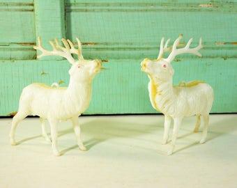 Two Vintage Hard Plastic Reindeer Ornaments