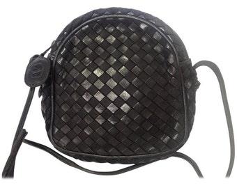 Vintage Valentino Garavani black intrecciato mini pouch style shoulder bag with V logo embossed pull. Classic purse.