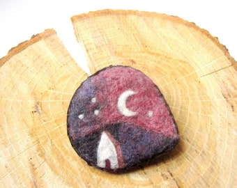 Felted pin, wearable art piece with a cottage and night sky with crescent moon.