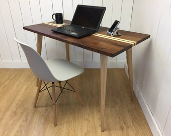 Mid century modern desk, solid black walnut with maple accents.