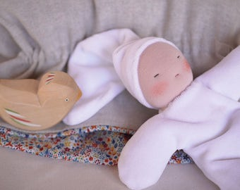 Set of waldorf toys for baby, white cuddle waldorf doll and a little rocking bird.