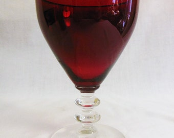 Ruby red wine glass with clear ribbed base offers considered