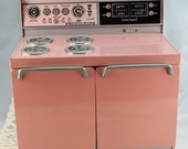 "1950s Little Girl's Play Stove, Frigidaire ""Electric"" Toy Stove, Pink Stove (AB)"