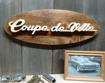 1959 Cadillac Coupe DeVille Emblem Oval Wall Plaque-Unique scroll saw automotive art created from wood.