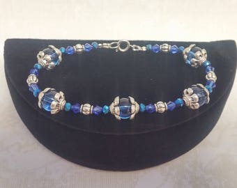 Blue Rounds with iridescent crystals and Tibetan Silver bead caps