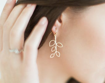 Delicate gold branch leaf earrings