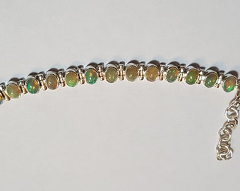 8.50ctw 7x5 mm Ethiopian Opal Sterling Silver Adjustable Bracelet 6-7.50 inch