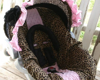 leopard/cheetah and black minky hood with baby pink satin ruffle and flower with leopard/cheetah with baby pink car seat cover