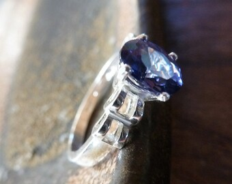 Tanzanite Trellis Ring is a lovely cornflower blue faceted oval gem and sterling silver carved size 7 ring.