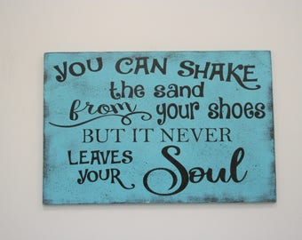 You Can Shake The Sand From Your Shoes But It Never Leaves Your Soul Wood Sign Beach House Decor Lake House Decor Distressed Wood Sign