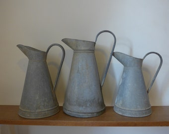 Assorted French antique zinc pitchers