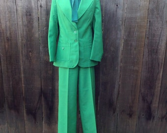 Bold green SUIT. Semi Fitted blazer and strainght leg pants.