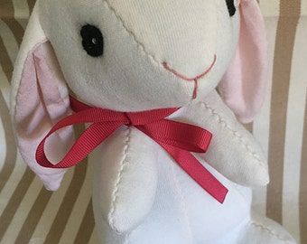 Darling 9 inch handsewn organic cotton rabbit in white with pink ears.