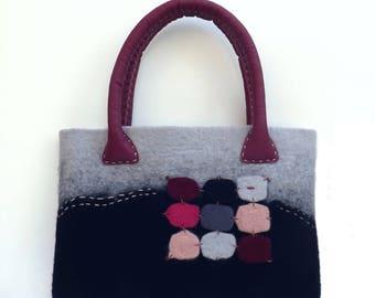 Merino Wool handbag leather handles with decorative wall plugs