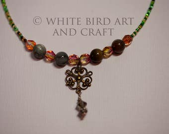 Beautiful gemstone and crystal bead necklace with seed beads.