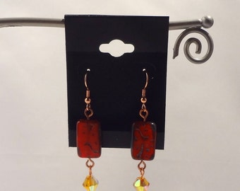 Red Picasso rectangle bead on copper earwire.  Amber glass bead dangle