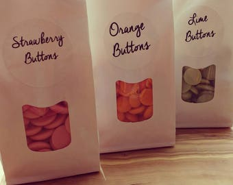 Flavoured Belgian chocolate  buttons. Orange. Strawberry. Or lime.
