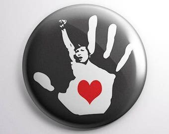 Heart in Hand 25mm button badge