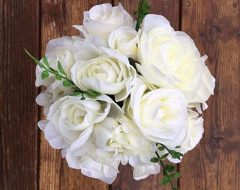 White rose and hydrangea bouquet with matching boutonnière