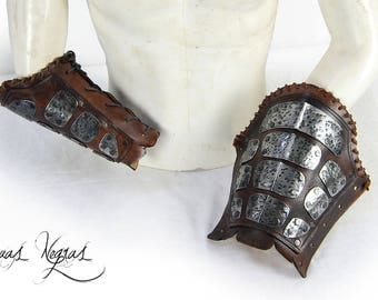 Warrior bracers made of leather and metal. Barbarian Bracers. Leather armor. Armor for LARP. Vikings bracers. Party costume. .
