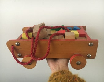 Vintage wooden wagon with toy blocks
