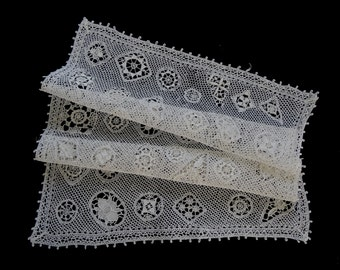 Antique handmade crocheted lace centerpiece doily -- off-white with a variety of flowers -- 23x17 inches / 58.5x43.5 cm