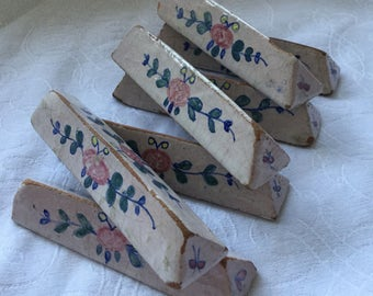 Seven Antique French Quimper stoneware knife rests