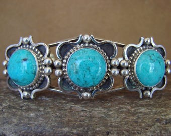 Navajo sterling silver cuff bracelet w/ 3 round turquoise stones