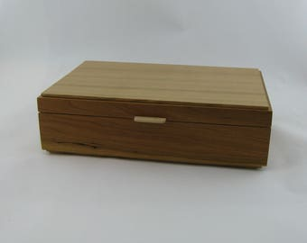 Tea box in Cherry on the side 12 X 7 3/4 x 3 1/4.Top is made from Cherry with vertical grain