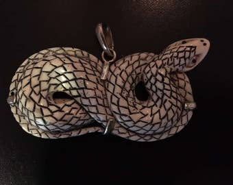 Hand-Carved Bone Pendant - Coiled Snake