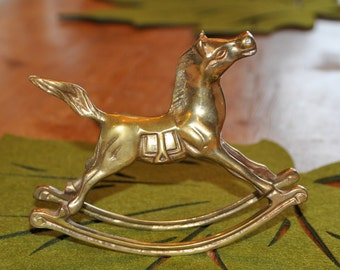 Little brass Rocking horse.  Such a sweet addition to a shelf in baby's room!