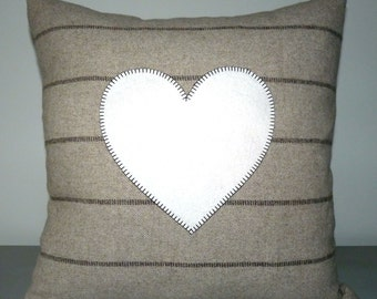 Striped wool cushion with heart appliqué