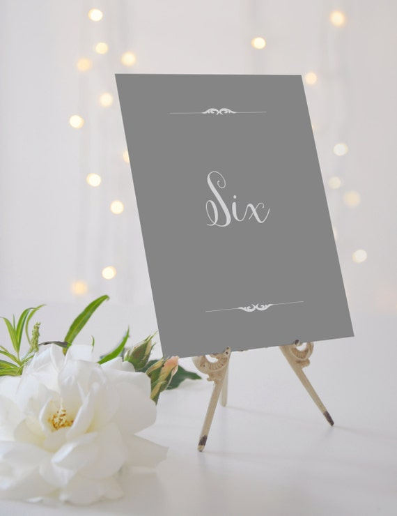Elegant wedding table numbers elegant table by for Elle king wedding dress designer