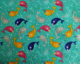 Narwhal flannel fabric.  Timeless Treasures KIDZ CF-4150.  Narwhals.  Aqua blue background.  100% cotton. Sold in 1 yard units.