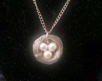 Bird's nest necklace, white eggs