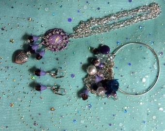 Vintage inspired necklace, bracelet and earring set.