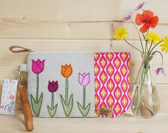 Clutch cover with colorful tulips applied in free motion