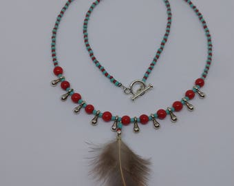 Unique Feather Pendant On A Beaded Necklace