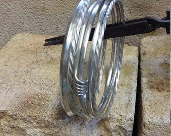 Stack of five fine silver bangles