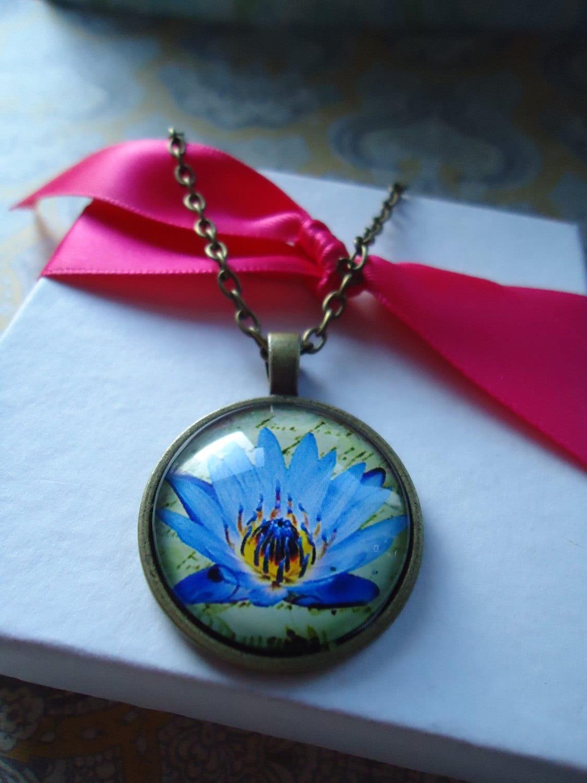 Keychains blue lotus bronze round glass keychainnecklace i love flowers blue lotus buycottarizona Choice Image