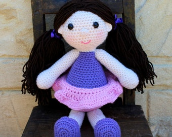 Handmade, crocheted toy doll for children and babies in purple and pink
