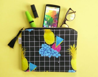 Fruit Punch zip pouch clutch bag with pineapple print and white grid