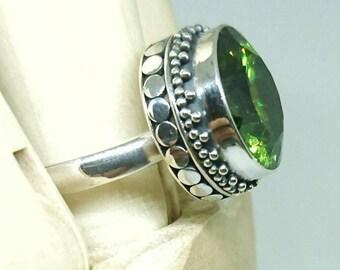 GAYA Bali Silver ring with 14mm peridot faceted stone