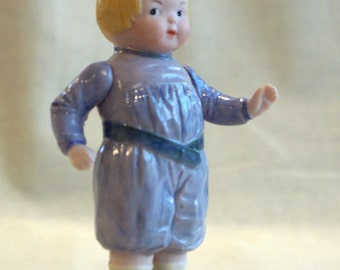 Mischievious Googly boy doll with movable arms