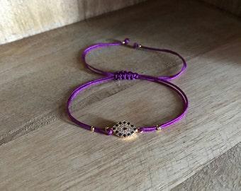Evil eye bracelet with purple string